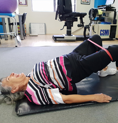 Elder lady doing hip raises