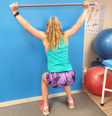 Young lady doing shoulder strengthening